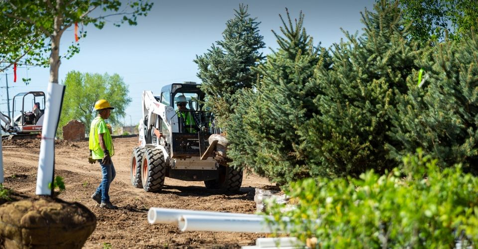 Large equipment and landscaper performing a landscape installation.