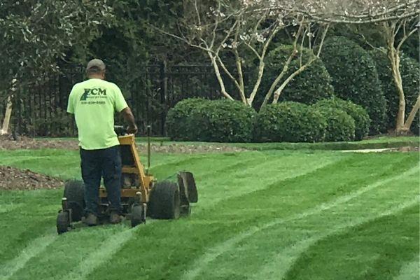 ECM employee mowing a customer's lawn.