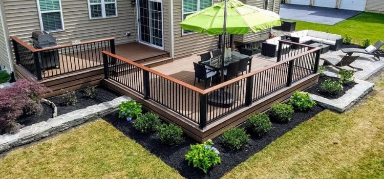 Deck with patio and recently installed new landscape design.