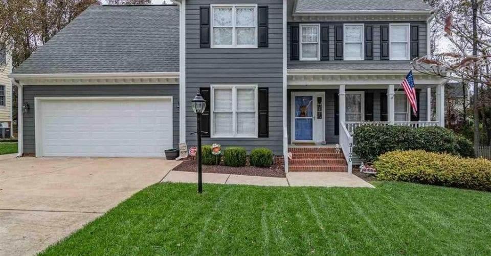 Weed free, green grass in front of a very nice home in Raleigh.