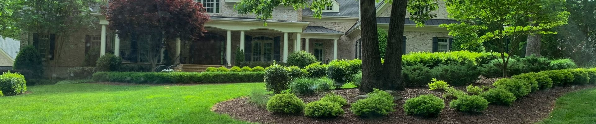 Wide angle shoot of a lawn and landscape customer's lawn.