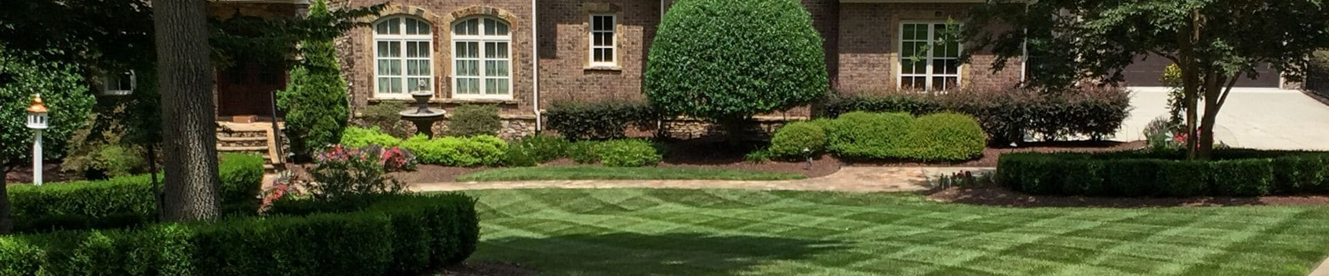 Beautiful lawn and landscape maintained by ECM Landscaping and Lawn Care in North Raleigh.