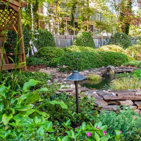 Backyard oasis maintained by ECM Landscaping and Lawn Care.