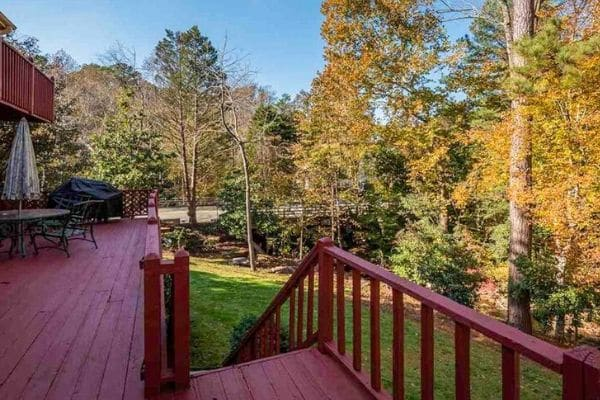 Deck view overlooking the back yard and woods beyond.