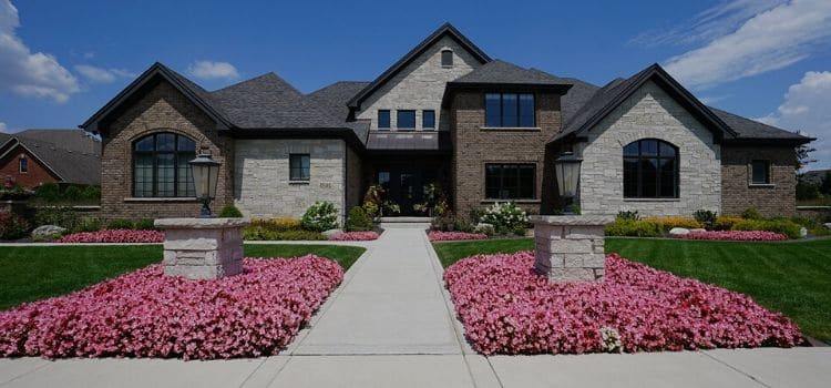 Very nice home with great lawn and landscape with many colorful seasonal flower arrangements.