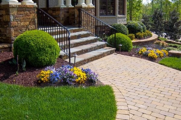 Seasonal flowers installed by ECM Landscaping and Lawn Care at the entrance of a customer's home.
